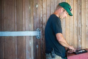 Farmer in barn using a laptop