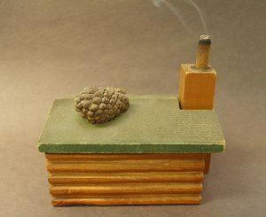 insence burner resembling a log cabin