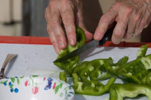 woman chopping bell peppers