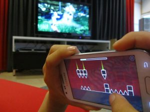 child playing game on a mobile device