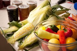 fresh produce and home-canned foods in canning jars