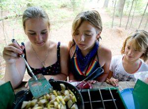 teens cooking at camp