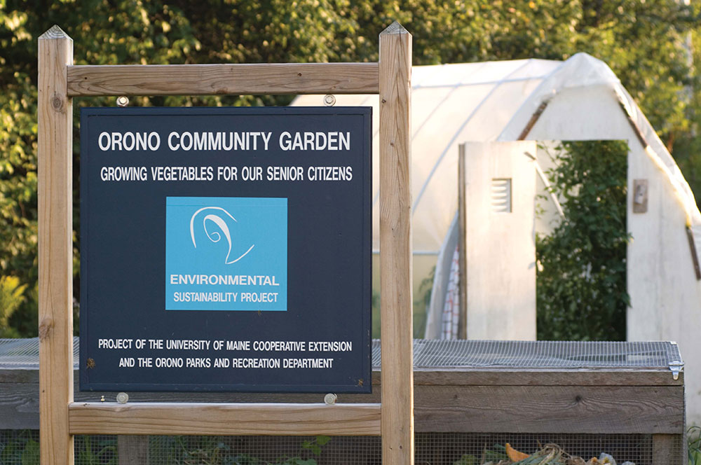 Community garden sign and hoop house in Orono, Maine