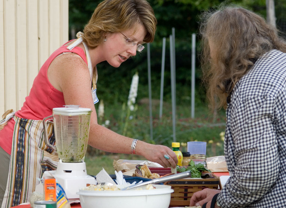 Extension staff demonstrates how to cook for crowds; photo by Edwin Remsberg