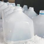 Milk jugs in snow