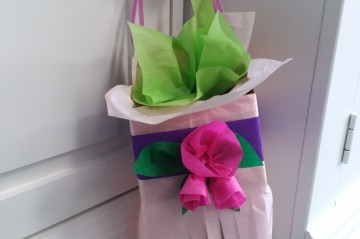 Basket made from colorful tissue paper hanging from door knob