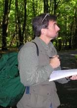 Picture of Prof. Ivan Fernandez collecting data in the woods