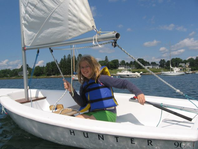 Girl sailing boat solo