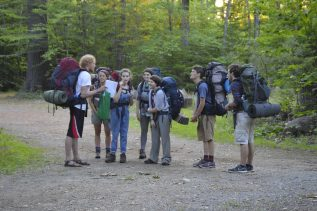 Counselor giving peptalk to hikers