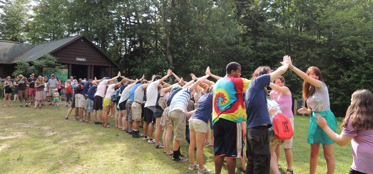 "Campers join hands to make a ""tunnel"""