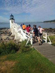 L2 campers running towards Marshall Point Light House