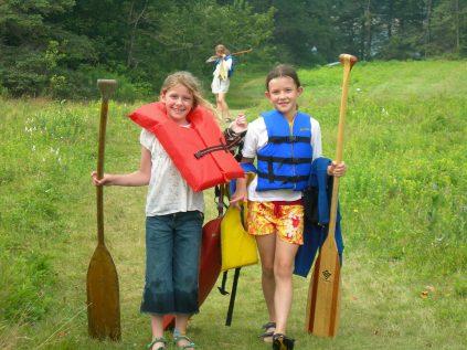 Two girls preparing to canoe