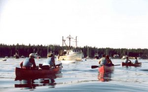campers canoeing through the harbor