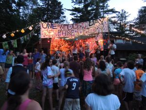 campers and staff gathered at camp music stage
