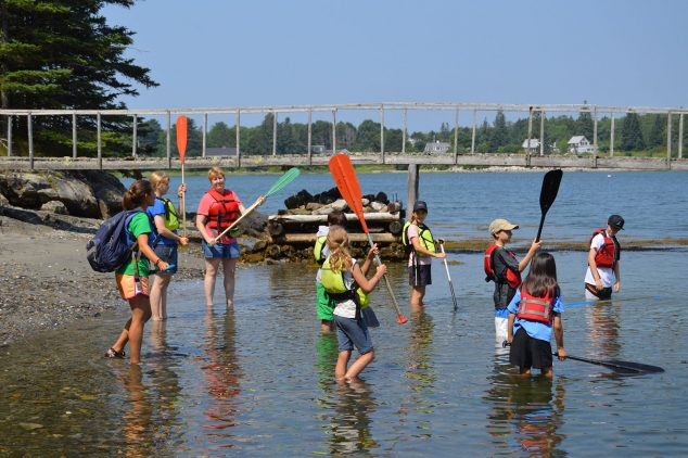 campers participate in paddling school