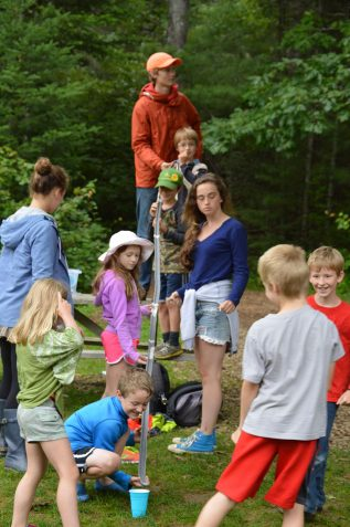"campers create a ""ski jump"" during a STEM activity"