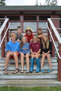 group of teen leaders sitting on camp steps