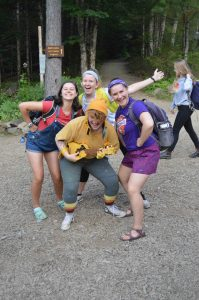Four colorful counselors huddle together