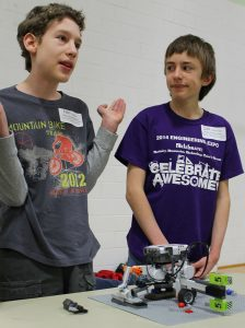 Youth explain their knowledge of robotics to a judge during the Washington County 4-H Robotics Expo.