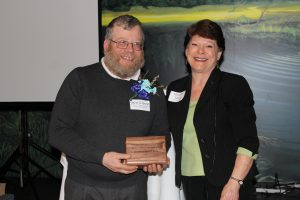 David O. Sivret (left) is presented with the Norman W. Duzen Community Service Award by Marianne Moore, WCEA President.