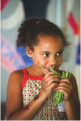 Youth eating vegetable.