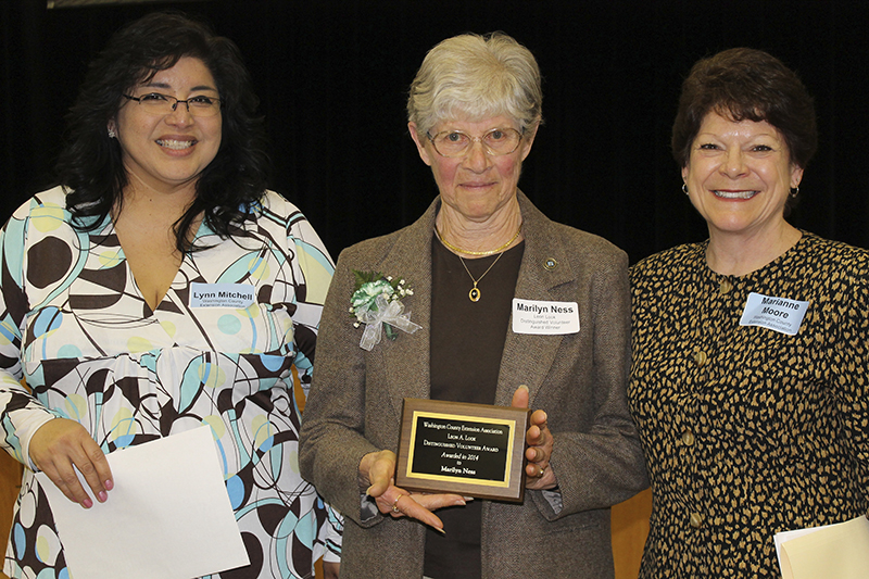 Washington County Extension Association (WCEA) Board Member Lynn Mitchell , left, and WCEA President Marianne Moore present the Leon Look Distinguished Volunteer Award to Marilyn Ness of Lubec, center, for her volunteer efforts with the Univeristy of Maine Cooperative Extension.