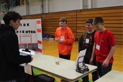 A youth team presents their project to a judge at the 2018 4-H Robotics Expo.