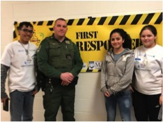 Game Warden Alan Curtis seen with the Teen Science Café Leadership Team.