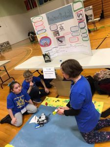A team watches their robot at the Washington County 4-H Robotics and Engineering Expo.