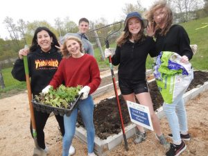Youth work at the 4-H Tech Changemakers garden.