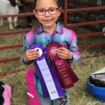 Zoe displays ribbons won at Northeast Livestock Expo.