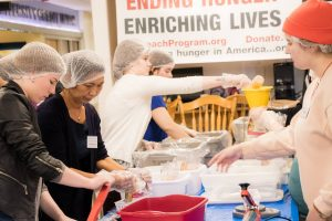 Volunteers pack food at the 2017 Maine Hunger Dialogue