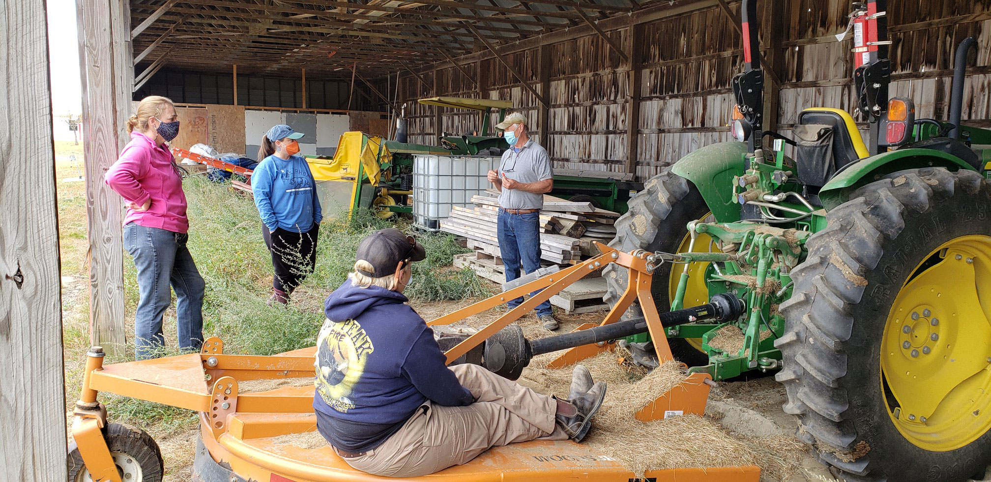 AgrAbility workshop held in barn, participants wearing masks