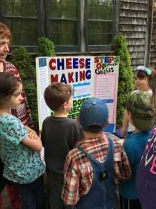 Nature Kids 4-H Club members with a cheese making display