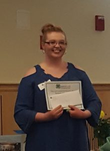 4-H member Bailey receiving a 4-H scholarship from the Maine 4-H Foundation