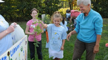 Maine Master Gardener Volunteer with participants of Kids Can Grow