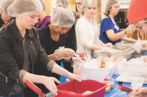 College students pack food for the Hunger Dialogue